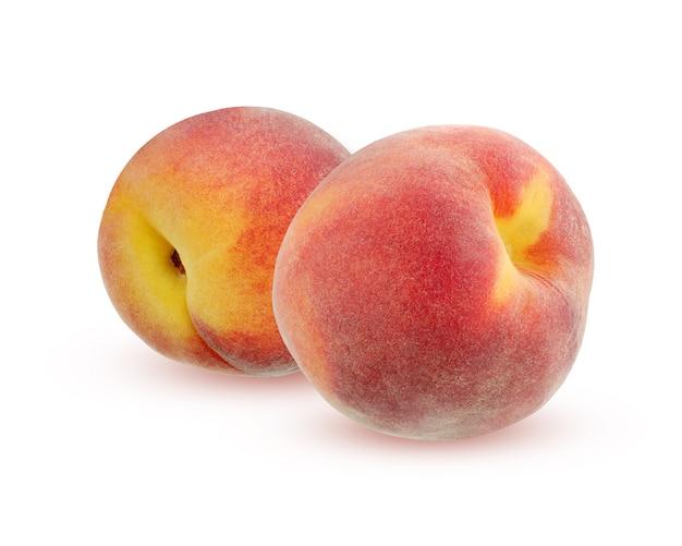 Zwei pfirsiche mit dem schatten, getrennt auf weißem hintergrund