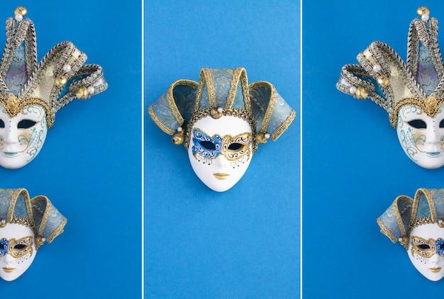 Zwei venezianische karnevalsmasken auf blauem hintergrund. ansicht von oben. standort vertikal.