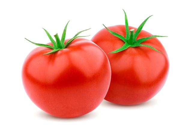 Zwei vollständige tomaten getrennt auf weiß