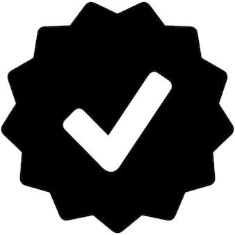 Approval symbol in starred badge