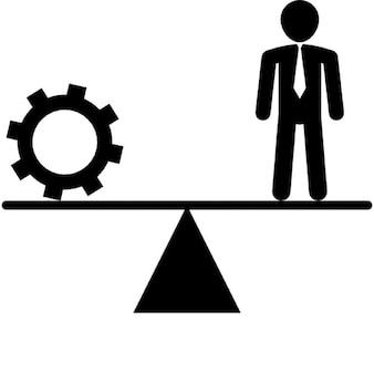 Balancing between cogwheel and businessman