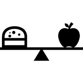 Burger and apple on a balancing scale