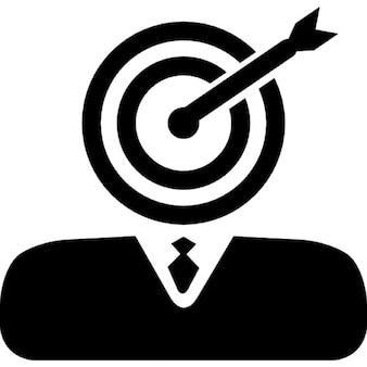 Businessman with dart board and dart head