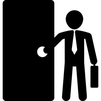 Businessman with suitcase opening door