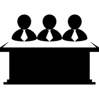 Businessmen team behind a desktop