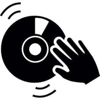 Dj hand on a vintage music disc