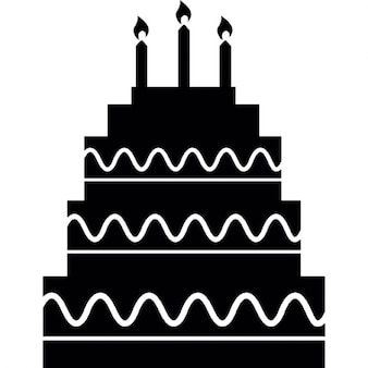 Five birthday cake layers with candles