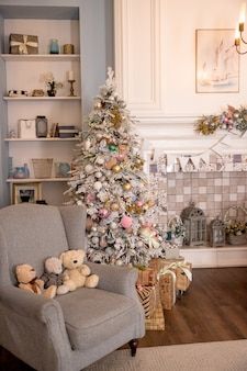 02.02.2019, saint-petersburg, russia, beautiful modern design of the room in delicate light colors decorated with christmas tree,decorative elements.interior design, magic atmosphere. pastel colors
