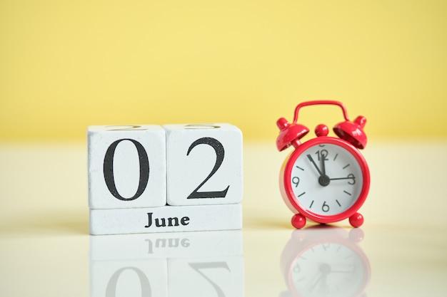 02 second june month calendar concept on wooden blocks.