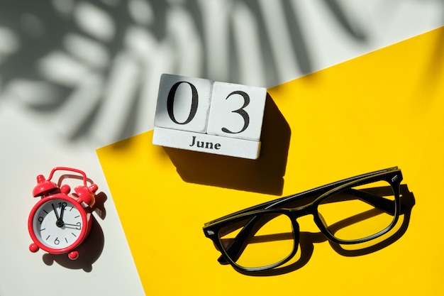 03 third june month calendar concept on wooden blocks.