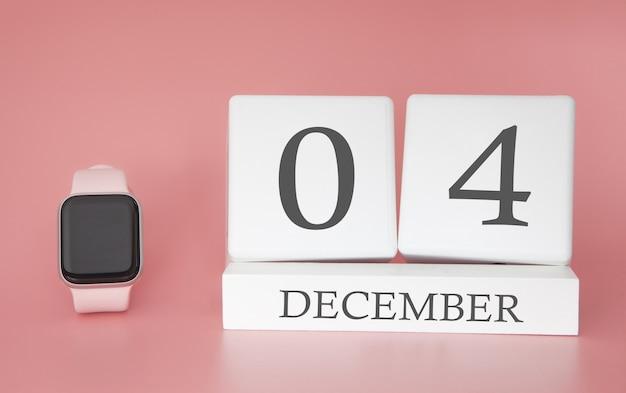 Современные часы с кубом календарь и дата 04 декабря на розовом фоне. концепция зимнего отдыха.