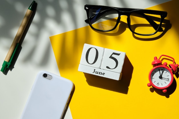 05 fifth june month calendar concept on wooden blocks.