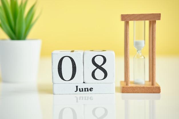 08 eighth june month calendar concept on wooden blocks.