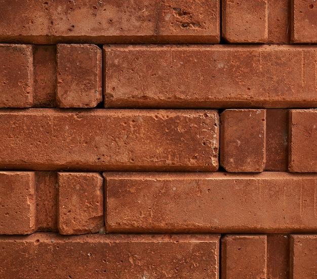 フルフレームの背景0fオレンジ色のレンガの壁