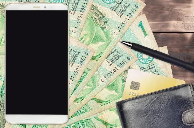 1ブラジルレアル紙幣とスマートフォン(財布とクレジットカード付き)