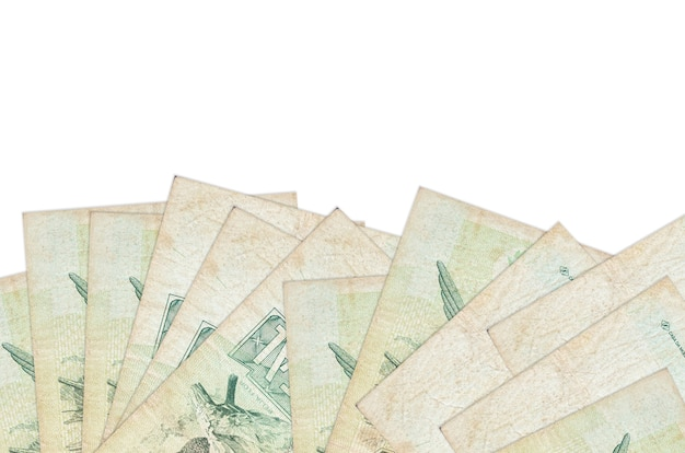 1 brazilian real bills lies on bottom side of screen isolated on white wall with copy space.