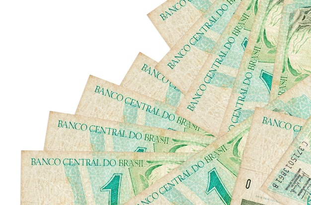 1 brazilian real bills lies in different order isolated on white. local banking or money making concept.