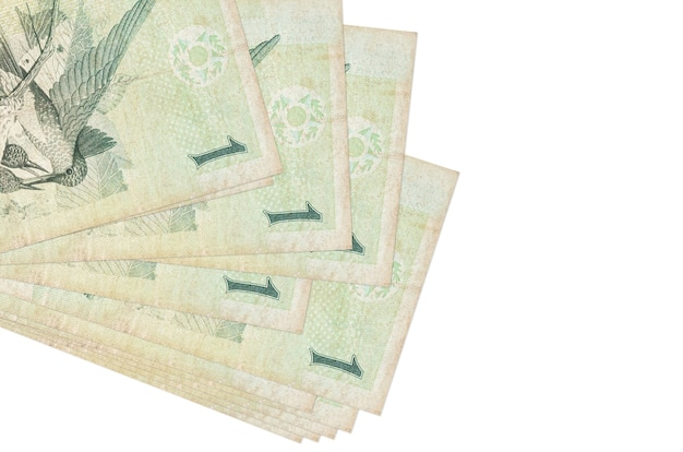 1 brazilian real bills lies in small bunch or pack isolated on white.  business and currency exchange concept