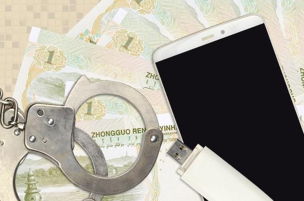 1人民元紙幣と警察の手錠付きスマートフォン