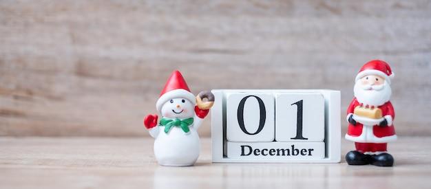 1 december calendar with christmas decoration, snowman, santa claus