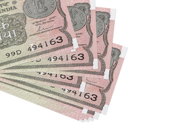 1 indian rupee bills lies in small bunch or pack isolated  .   business and currency exchange concept