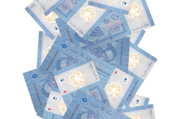 1 malaysian ringgit bills flying down isolated on white