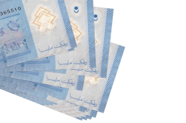 1 malaysian ringgit bills lies in small bunch or pack isolated on white.  business and currency exchange concept