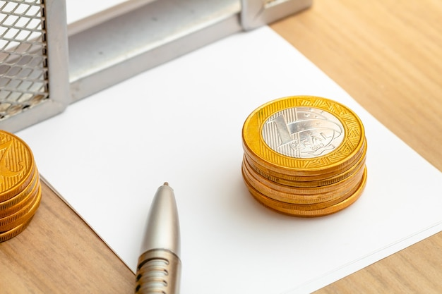 1 real coins in macro photography for money saving concept and brazilian economy