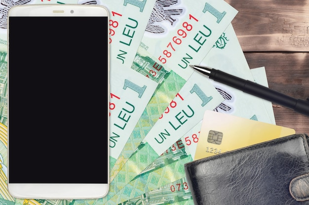 1 romanian leu bills and smartphone with purse and credit card