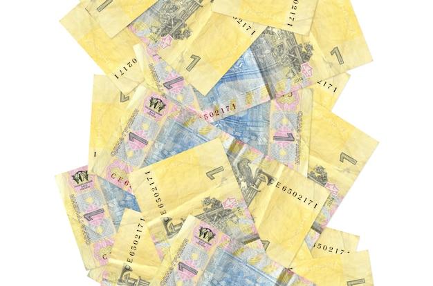 1白で隔離されて飛んでいるウクライナグリブナ手形。多くの紙幣が左右に白いコピースペースで落ちています