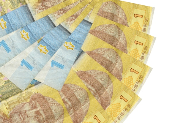1 ukrainian hryvnia bills lies isolated on white background with copy space stacked in fan shape close up
