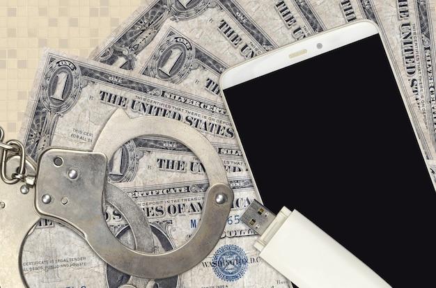 1 долларовая купюра и смартфон с полицейскими наручниками