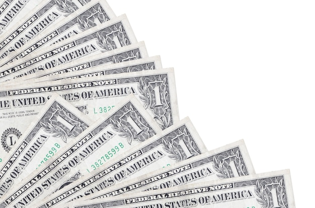 1 us dollar bills lies isolated on white background with copy space stacked in fan close up