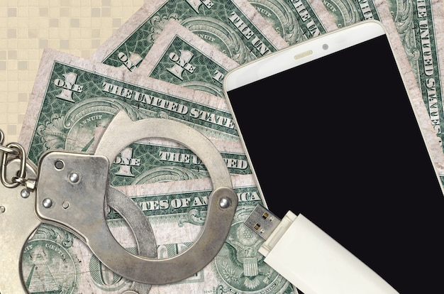 1 us dollar bills and smartphone with police handcuffs. concept of hackers phishing attacks, illegal scam or online spyware soft distribution