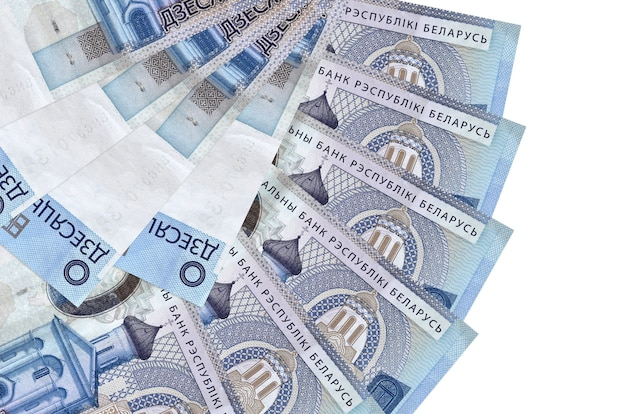 10 belorussian rubles bills lies isolated on white wall with copy space stacked in fan shape close up. financial transactions concept