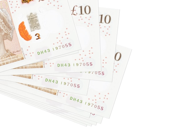 10 british pounds bills lies in small bunch or pack isolated on white