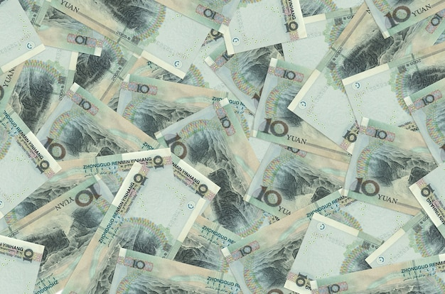 10 chinese yuan bills lies in big pile. rich life conceptual background. big amount of money