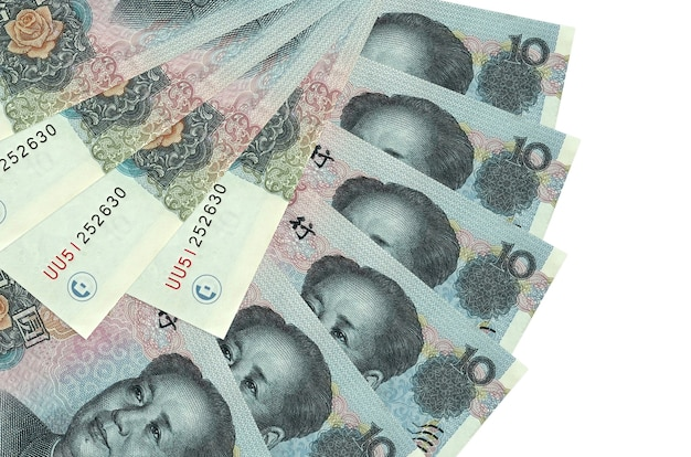 10 chinese yuan bills lies isolated   stacked in fan shape close up. financial transactions concept