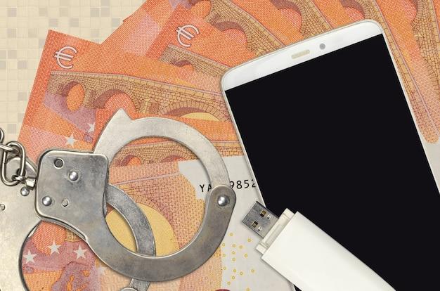 10ユーロ紙幣と警察の手錠付きスマートフォン
