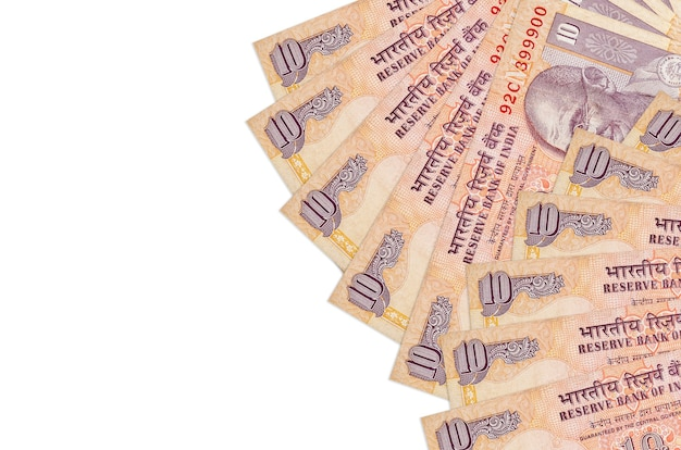10 indian rupees bills lies isolated on white wall with copy space. rich life conceptual wall. big amount of national currency wealth