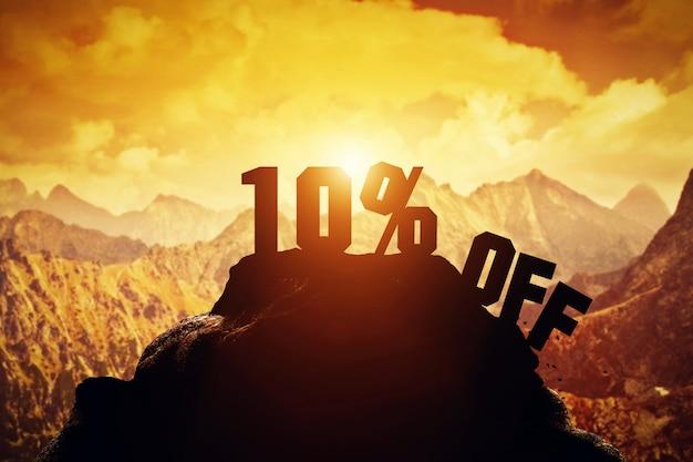 10% off writing on a mountain peak.
