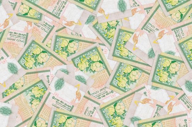 10 sri lankan rupees bills lies in big pile
