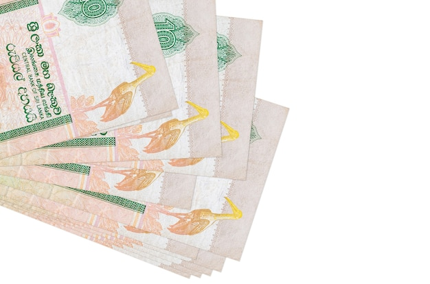 10 sri lankan rupees bills lies in small bunch or pack isolated on white. business and currency exchange concept