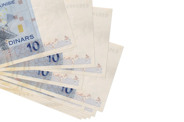 10 tunisian dinars bills lies in small bunch or pack isolated on white.  business and currency exchange concept