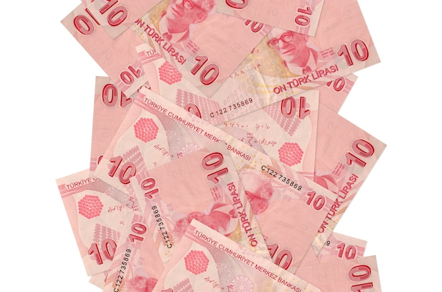 10 turkish liras bills flying down isolated on white. many banknotes falling with white copy space on left and right side