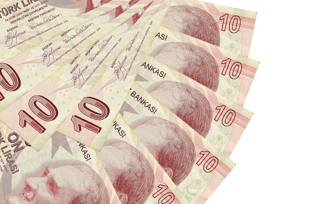 10 turkish liras bills lies isolated on white background with copy space stacked in fan shape close up