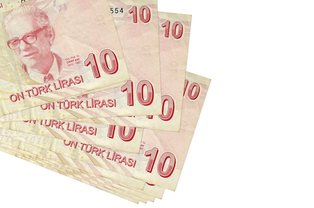 10 turkish liras bills lies in small bunch or pack isolated on white