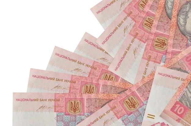10ウクライナグリブナの請求書は白で隔離された異なる順序であります。ローカルバンキングまたは金儲けの概念。