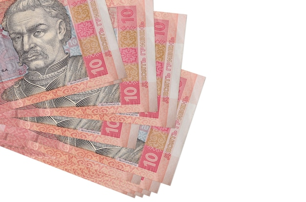 10 ukrainian hryvnias bills lies in small bunch or pack isolated on white