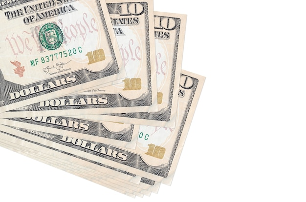 10 us dollars bills lies in small bunch or pack isolated on white